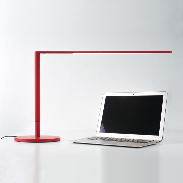 designed with a wispythin silhouette the lady7 desk lamp provides a clear