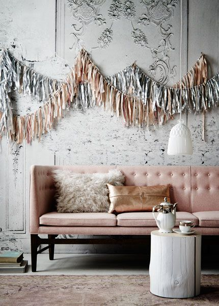 A fringed swag in coordinating colors add a beautiful accent to the party decor.  (dwellings and décor)