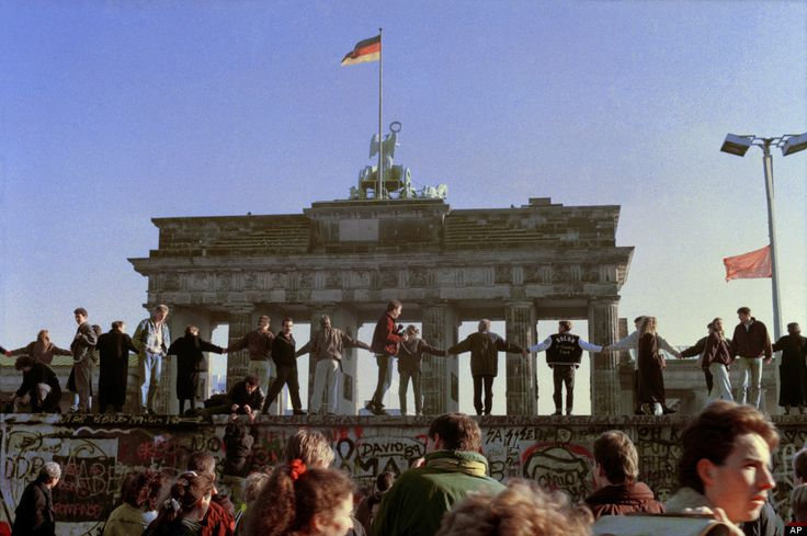 Berliners sing and dance on top of The Berlin Wall to celebrate the opening of East-West German borders in this Nov. 10, 1989 file picture. (AP Photo/Thomas Kienzle, File)