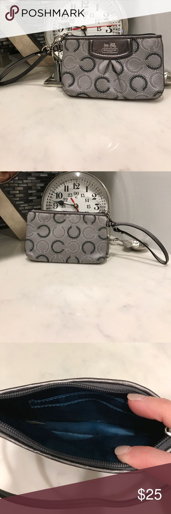 Small Authentic Coach wristlet Authentic Coach wristlet. Small, grey and great for throwing your cash/credit card and photo ID in for a night on the town! Coach Bags Clutches & Wristlets