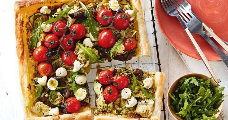 For a delicious vegetarian main try this golden, puff pastry tart served with fresh baby rocket leaves.