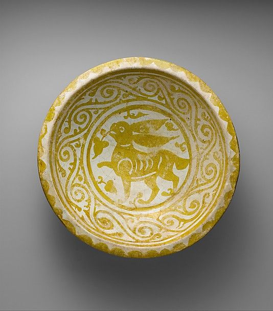 Bowl Depicting a Running Hare Object Name: Bowl Date: first quarter 11th century Geography: Egypt Medium: Earthenware; luster-painted on opaque white glaze