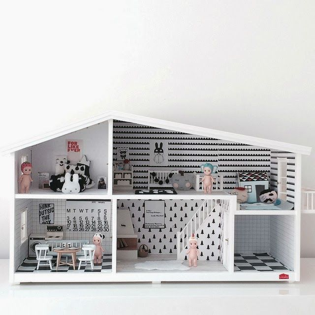 Black and white wooden dolls house