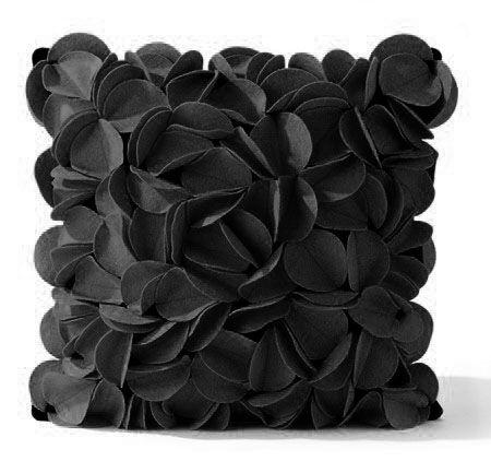 """Black """"flower petals"""" throw pillow."""