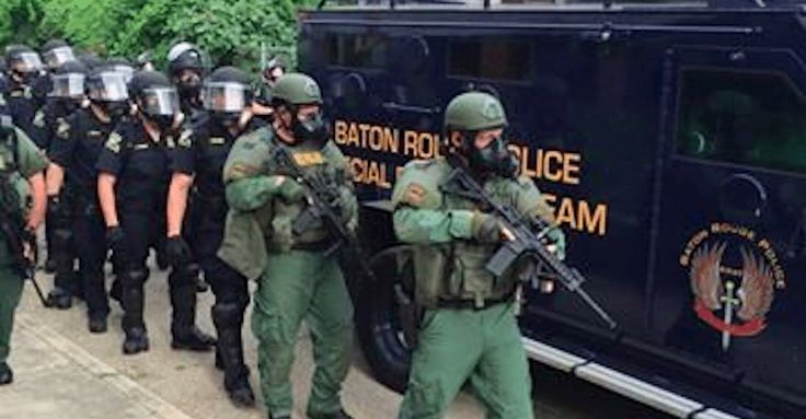 Protesters in Baton Rouge have been met with a wave of police in full riot gear, with dozens arrested at a gathering near the corner of France and East.