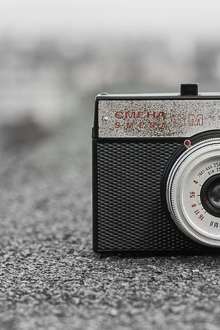 Black and Gray Classic Camera on Gray Concrete