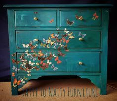 Loving the painted butterflies on this beautiful blueish dresser! This would be perfect in a bed room.