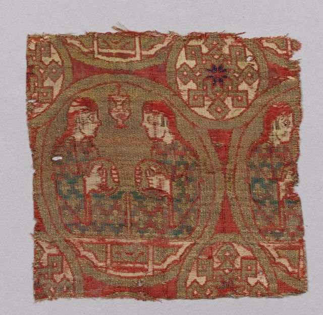 This textile is from 13th century Spain, also silk lampas with gilt silk thread. It is 10.3 cm high and 10.8 cm wide. The textile features tambourine players wearing clothes with geometric designs. This textile piece was found with other textile fragments in a 13th century manuscript in the cathedral of Vich. This textile can be found in the Metropolitan Museum of Art.