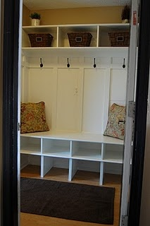 Mud Room. Cute idea for the front entrance with a hook and cubby for each kid. Put a calendar below the hook for them to keep track of schedules. Shoes go in the cubbies. I'll have to remember this if we get the house we want!