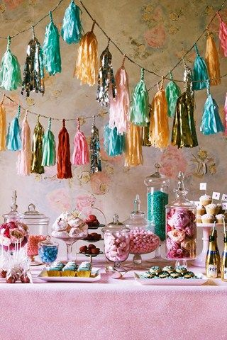 Colorful Sweets Table, via Brides UK.  Garlands by Other Criteria, click for full credits.