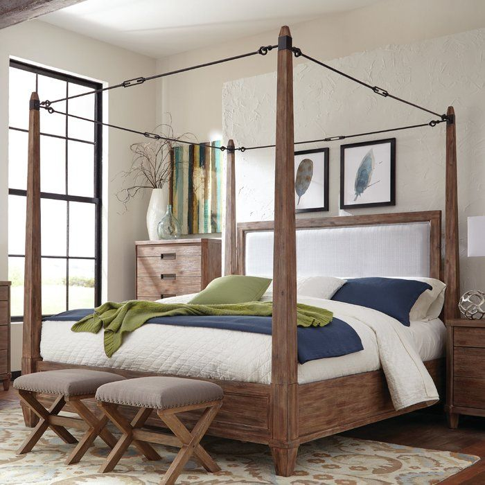 Constructed of solid acacia wood and acacia veneer, the Madeleine bedroom collection will make a bold impression in your bedroom. Finished in smoky acacia. The metal turn buckle canopy frame is a standout feature.