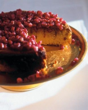 Pomegranate Jewel Cake Many cultures use food that resembles money – lentils for coins, saffron for gold – in celebratory meals, to invoke a wish for prosperity and good fortune ahead, and this fragrant, light, flourless almond cake with its tumble of gleaming, rubied pomegranate seeds is my version: an open jewel-case of a cake.