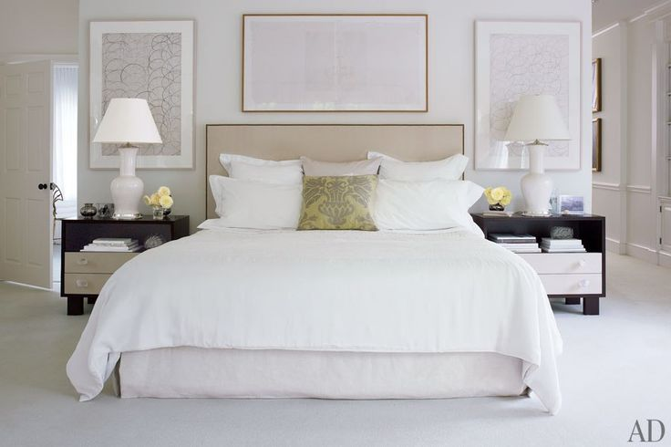 The room's bedside tables are by Victoria Hagan Home Collection, the headboard was custom made, the lamps are by Antony Todd, the bed linens are by Frette, and the white silk coverlet is by Calvin Klein Home.