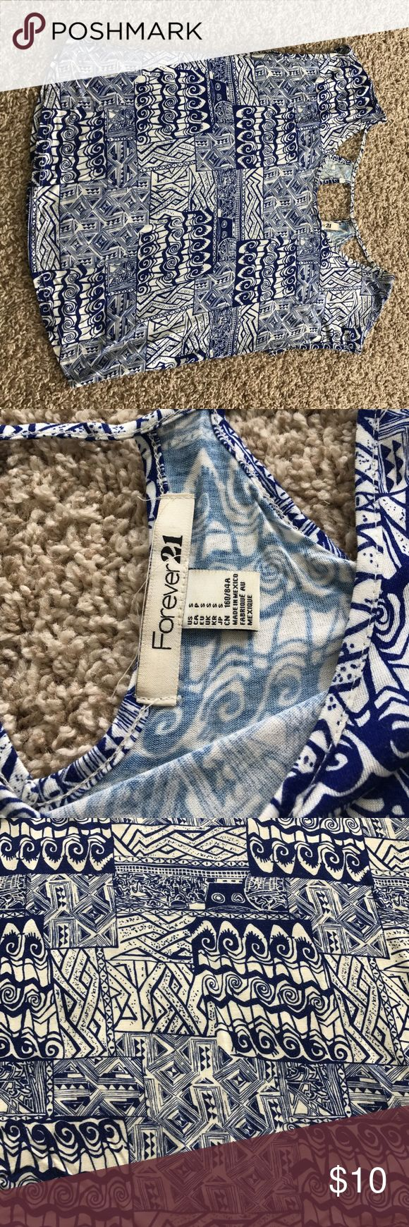 """Forever 21 blue and white printed top size S Forever 21 blue and white """"Aztec"""" printed top, size S, cut out details on back up top. Slight wear. Loose fit, little short Forever 21 Tops Tees - Short Sleeve"""