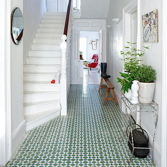 A green-and-blue patterned floor looks fresh against white walls. Via Red Online.