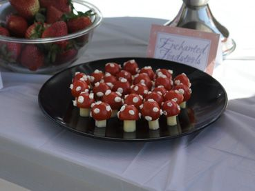 "1/4th of a cheese stick, 1/2 a cherry tomato, ""glue"" together with cream cheese mixed with ranch dressing, and decorate the top with the same. SO CUTE!"