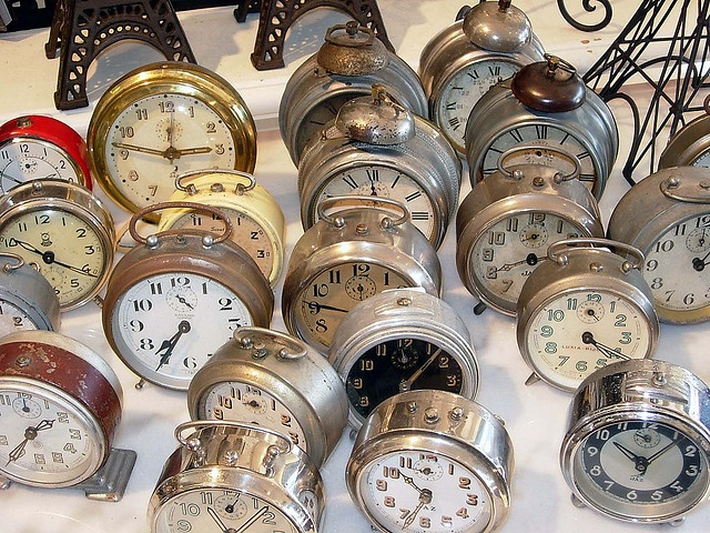 I love the idea of clocks set all about the house at a New Years eve party ... all set to go off at midnight, of course!