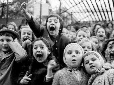 Wide Range of Facial Expressions on Children at Puppet Show the Moment the Dragon is Slain. By Alfred Eisenstaedt
