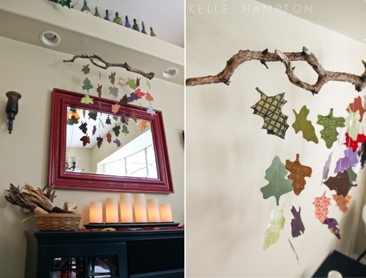 awesome idea for fall decor.  old branch with paper leaves strung on it.  trade out leave for snowflakes come winter.  thank you kelle at www.kellehampton.com - you're awesome