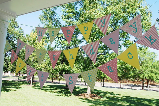 Pennant Birthday Banner. Wood triangles covered with scrapbook paper.