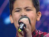 After Simon's typical rude behavior stopped this boy from performing his first choice of a song, he went a different route...and blew everyone away! Even Simon. What a God-given talent.
