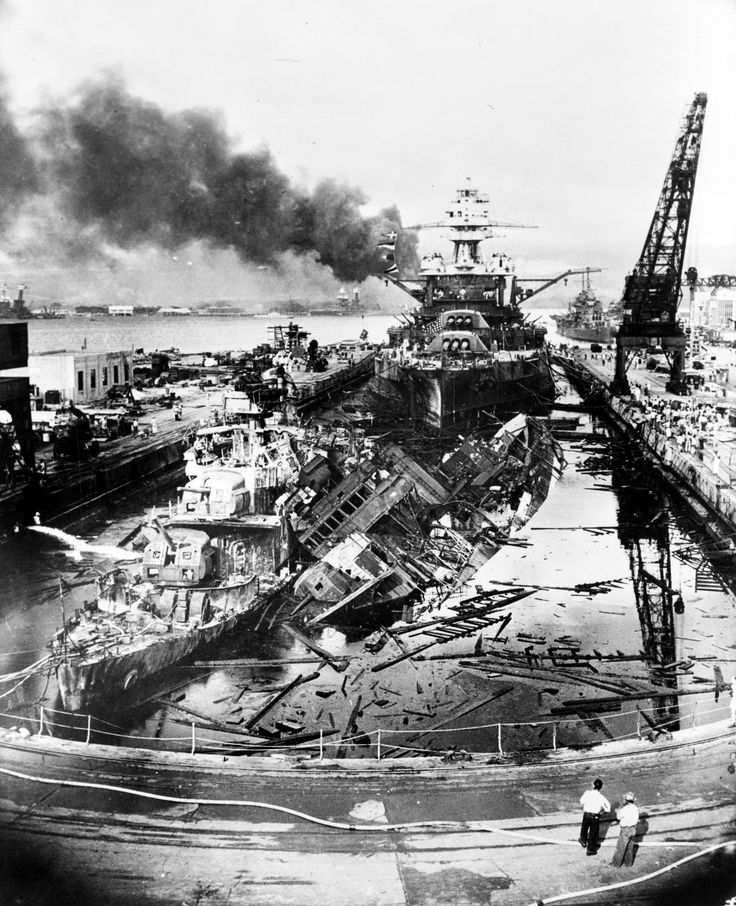 LC-USZ62-136130: Japanese attack on Pearl Harbor, December 7, 1941. The wrecked destroyers USS Downes (DD-375) and USS Cassin (DD-372) in Drydock One at the Pearl Harbor Navy Yard, soon after the end of the Japanese air attack. Cassin has capsized against Downes. USS Pennsylvania (BB-38) is astern, occupying the rest of the drydock. The torpedo-damaged cruiser USS Helena (CL-50) is in the right distance, beyond the crane. Visible in the center distance is the capsized USS Oklahoma (BB-37),