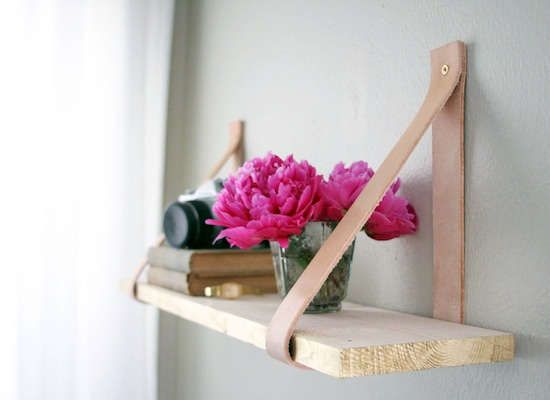 Make your own shelf with leather straps and a wooden board