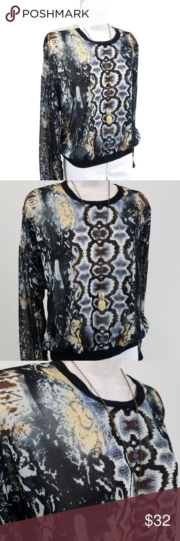 CAbi semi sheer python print top Dressed up sweatshirt in python print: long-sleeved crew neck top cut like a sweatshirt but made of a semi-sheer python / snake print.  Dropped shoulder.  Style 572.  Bust 22 / length 23 inches.  100% polyester. CAbi Tops