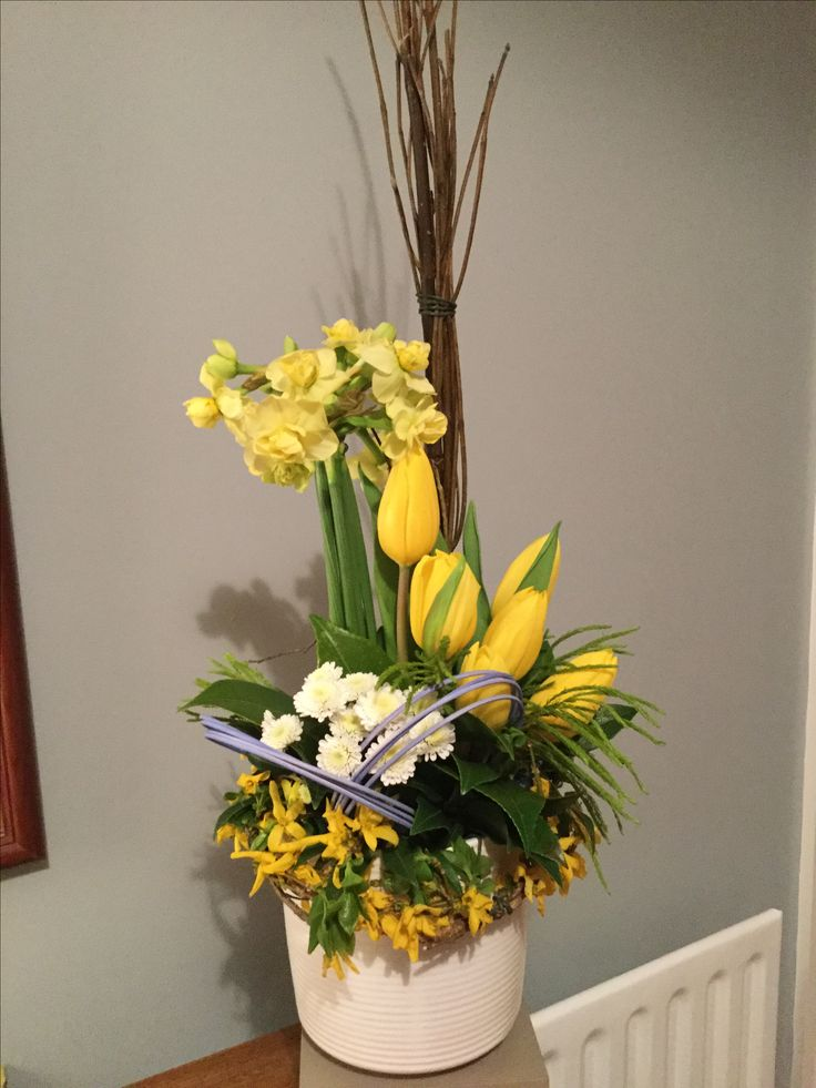 Spring arrangement daffodils, tulips, chrysanthemums and forsythia.