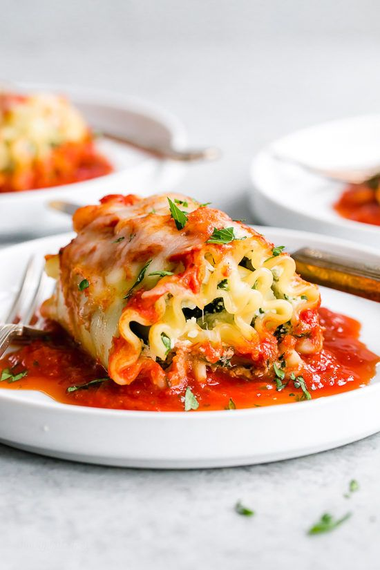 These EASY Spinach Lasagna Roll ups are totally delicious, perfect for entertaining or serving for weeknight meals. Freezer friendly directions provided!