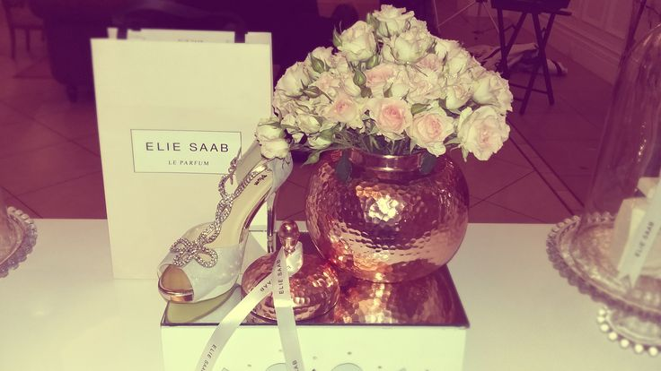 A sparkly sandal complements the display on the Elie Saab Perfume stand