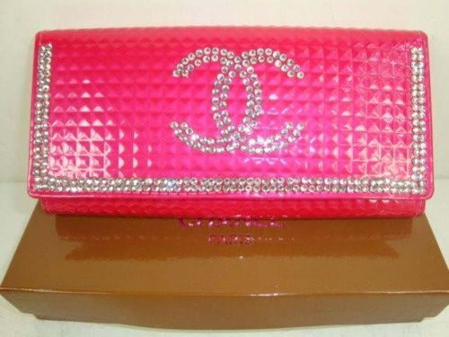 <3!!!!!!!!!!!! Pink Chanel wallet with rhinestones.
