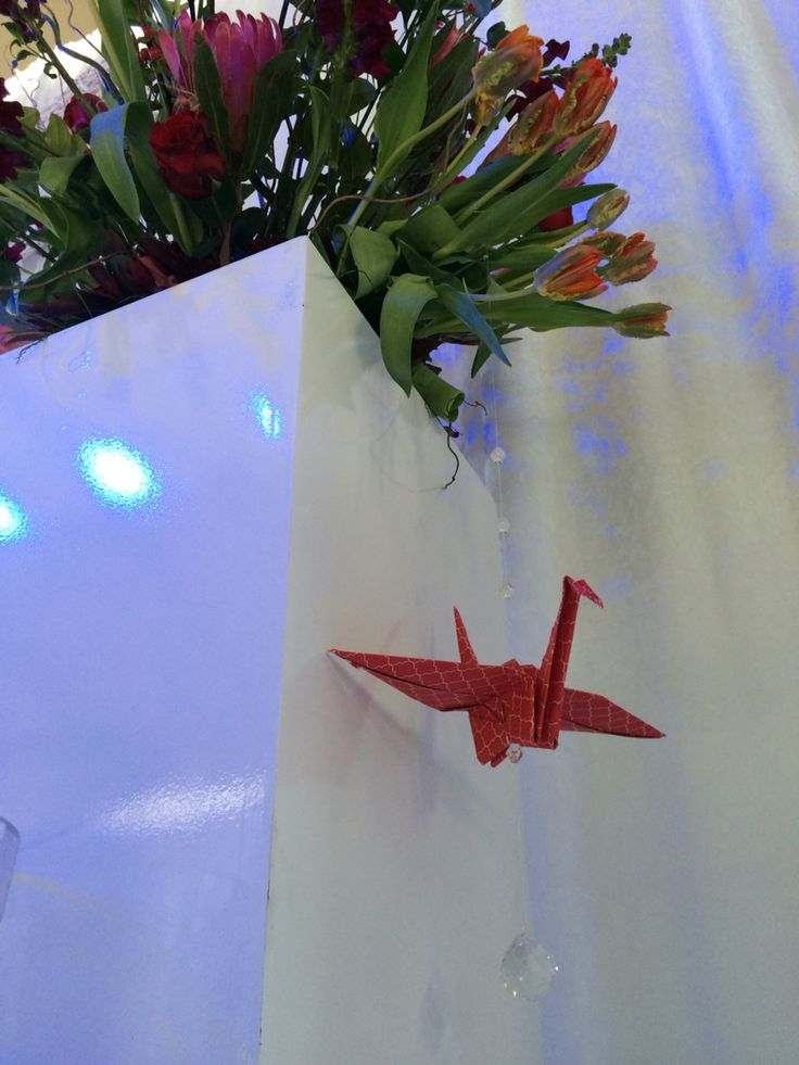 Origami bird can add a touch of quirkiness to any floral arrangements