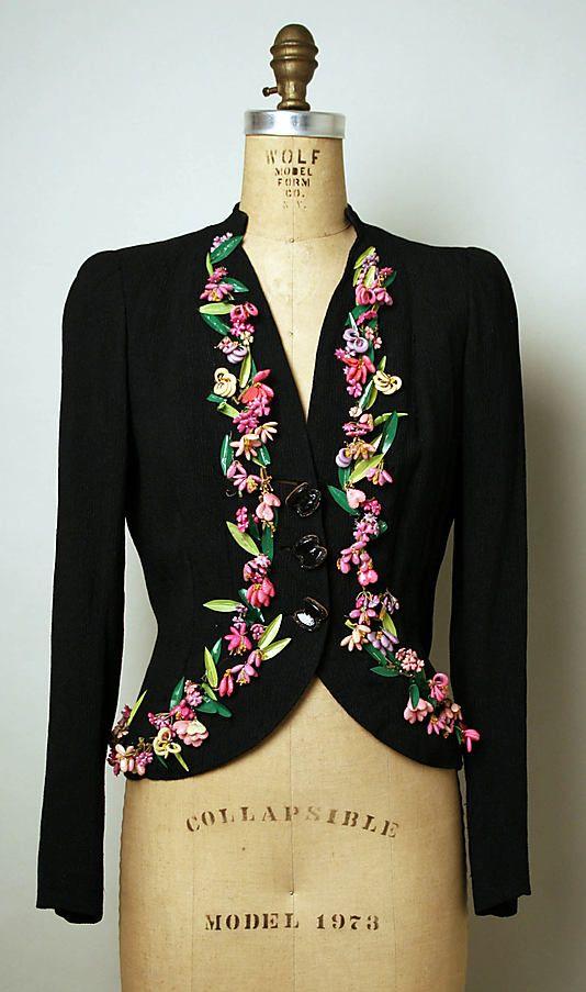 Jacket, Evening.  Elsa Schiaparelli (Italian, 1890–1973).  Date: winter 1937–38. Culture: French. Medium: silk, plastic. Dimensions: Length at CB: 22 1/2 in. (57.2 cm).