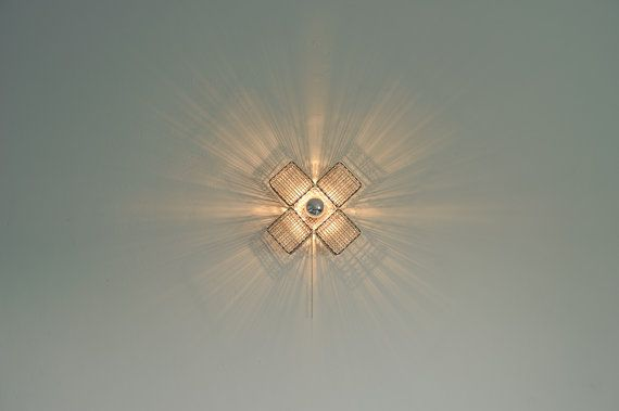 Metal cross  wall light by herywalery on Etsy, €85.00
