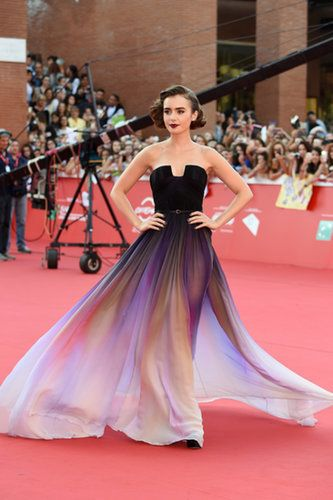 """Lily Collins attends the premiere of """"Love, Rosie"""" during the 2014 Rome Film Festival in Rome, Italy. Lily Collins is wearing an Elie Saab couture strapless chiffon gown accessorised with earrings by Norman Silverman and ring by EF Collection rings, Vita Fede and Melissa Kaye Jewelry."""