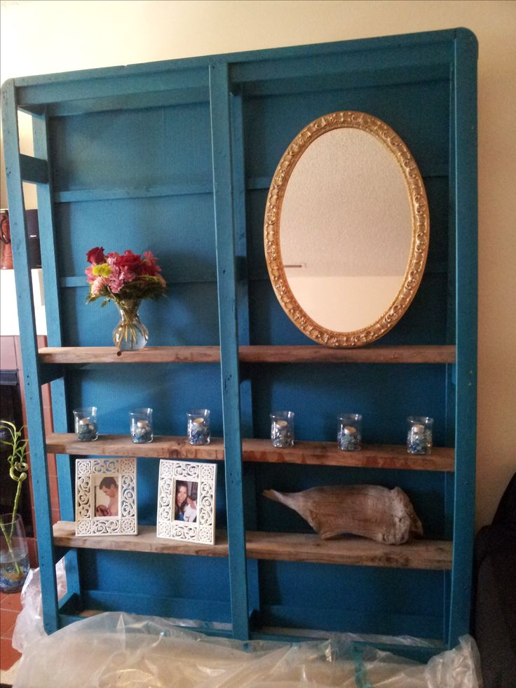This shelving unit was made from the box spring of an old bed. They tore off the fabric, painted the entire thing and added old barn boards. Fabulous!!!