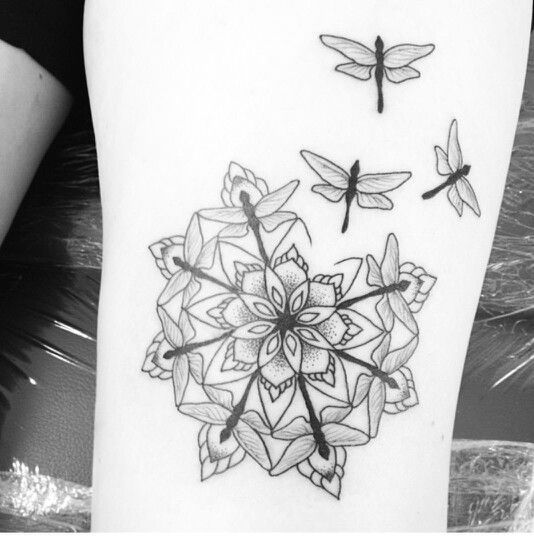 Dragonflies combine to make a mandala design in this spiritual nature tattoo  love but with some color