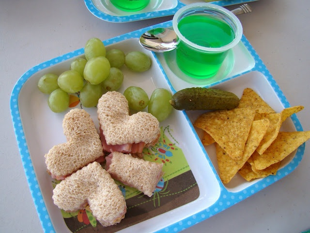 St. Patrick's Day Lunch: When making lunch for your little ones, keep the themes of the color green and shamrocks going. Make cute little sandwiches in the shape of shamrocks and include green grapes and green jello.