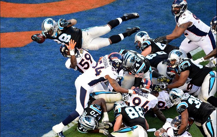 Jonathan Stewart of the Carolina Panthers scores the Panthers' first point by jumping into the end zone against the Denver Broncos in the second quarter of Super Bowl 50 at Levi's Stadium on Feb. 7, 2016, in Santa Clara, Calif.