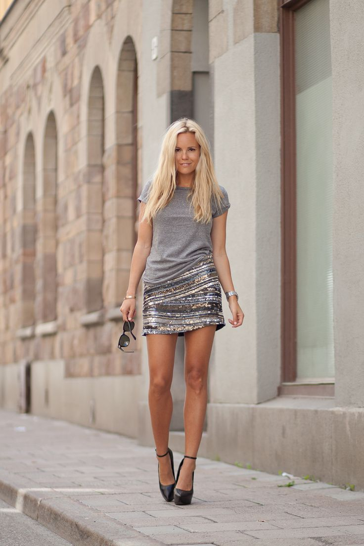 Look effortlessly chic by pairing a casual t-shirt with your sequined skirt as seen on Sofi Fahrman: H&M tee, Hankydory skirt, Theyskens Theory pumps #StreetStyle