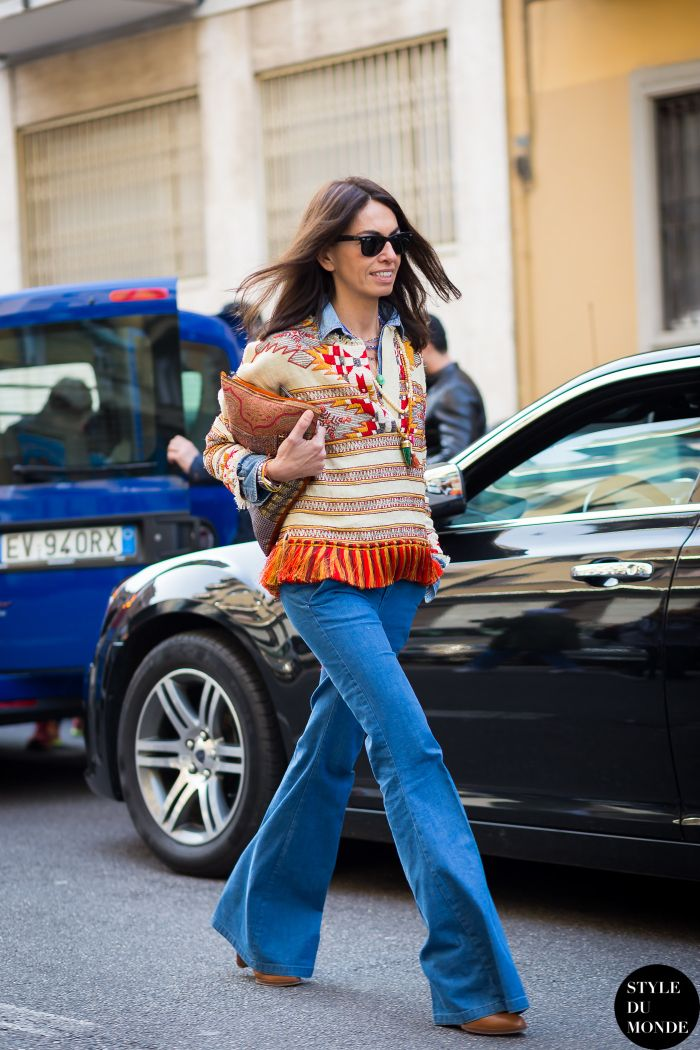 colorful boho blouse with flared jeans