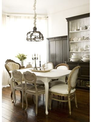 Add charm to a dining room by mixing and matching chairs around the table. Tip: choose a common hue to tie them all together. #personalstyle #decorating