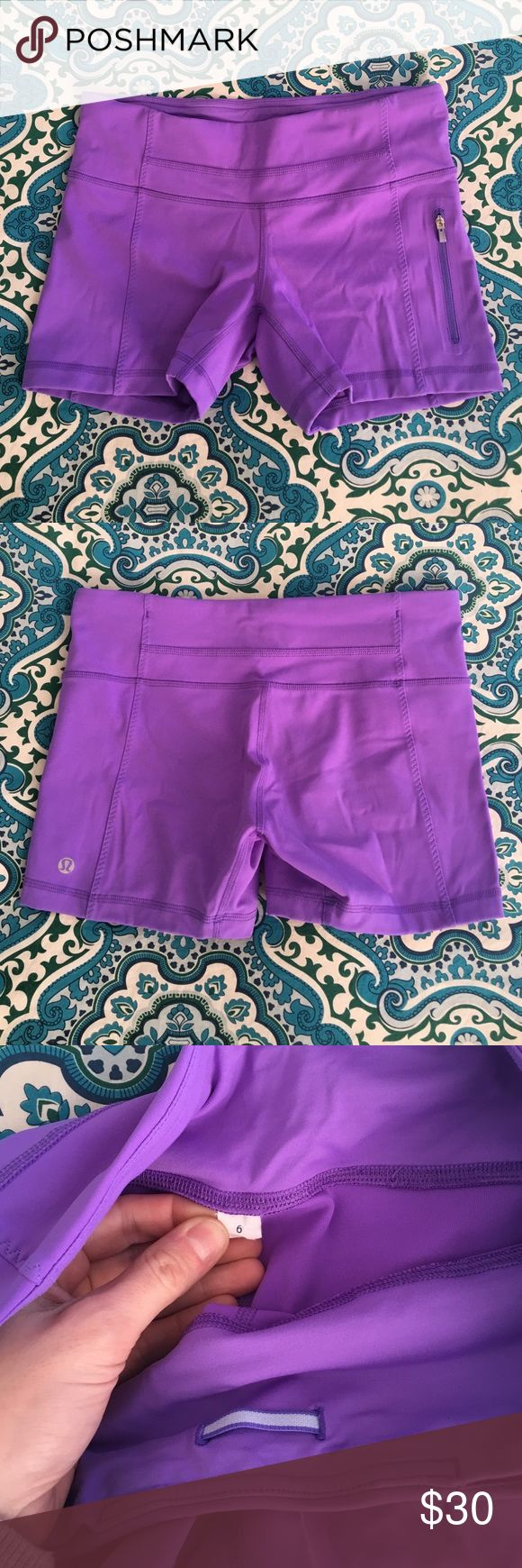 "Purple Lululemon running yoga shorts size 6 Pair of purple Lululemon running shorts in excellent gently-used condition. Zippered pocket on the left leg and two hidden waistband pockets. Inseam measures 3.75"". lululemon athletica Shorts"