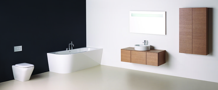Add a touch of texture to your bathroom with a wood finish on your storage units. @SottiniUK