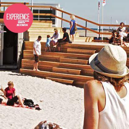 Når solen står højt på himlen, og det eneste der er tiltrængt, er at smide skoene og få vind i højet, så ta' til Strandbaren! Her er der også mulighed for at opleve alle de nye arkitektoniske havnebyggerier på tæt hånd. Ta' en ven i hånden og drik bobler ved vandet. #EXIWDK Anbefalet af Nanna Lund Lauridsen, bachelorstuderende på Aarhus Universitet