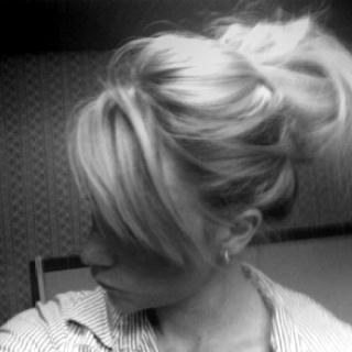 Messy bun with long hair.