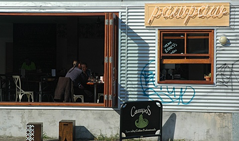 Paw Paw cafe's shop exterior with corrugated iron wall