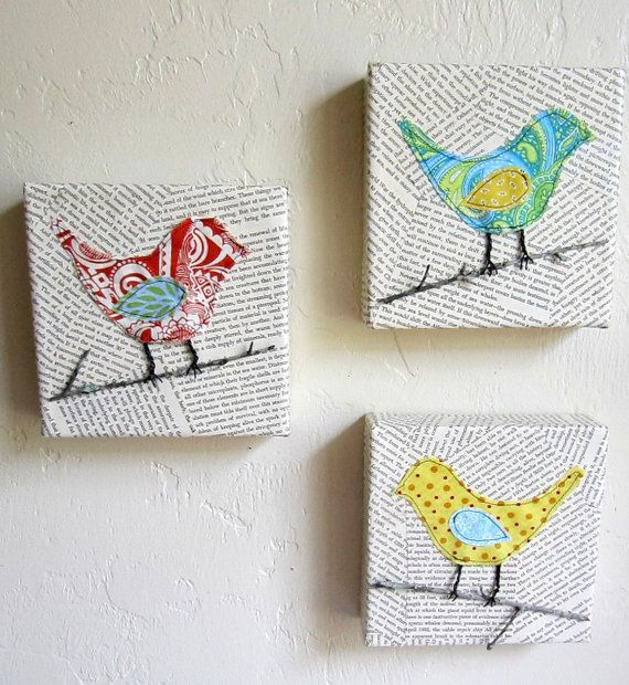 Each canvas features a different brightly colored bird perched on a real twig, with little wire legs, against a background of decoupaged vintage book pages. From Etsy - Agoodhome Shop
