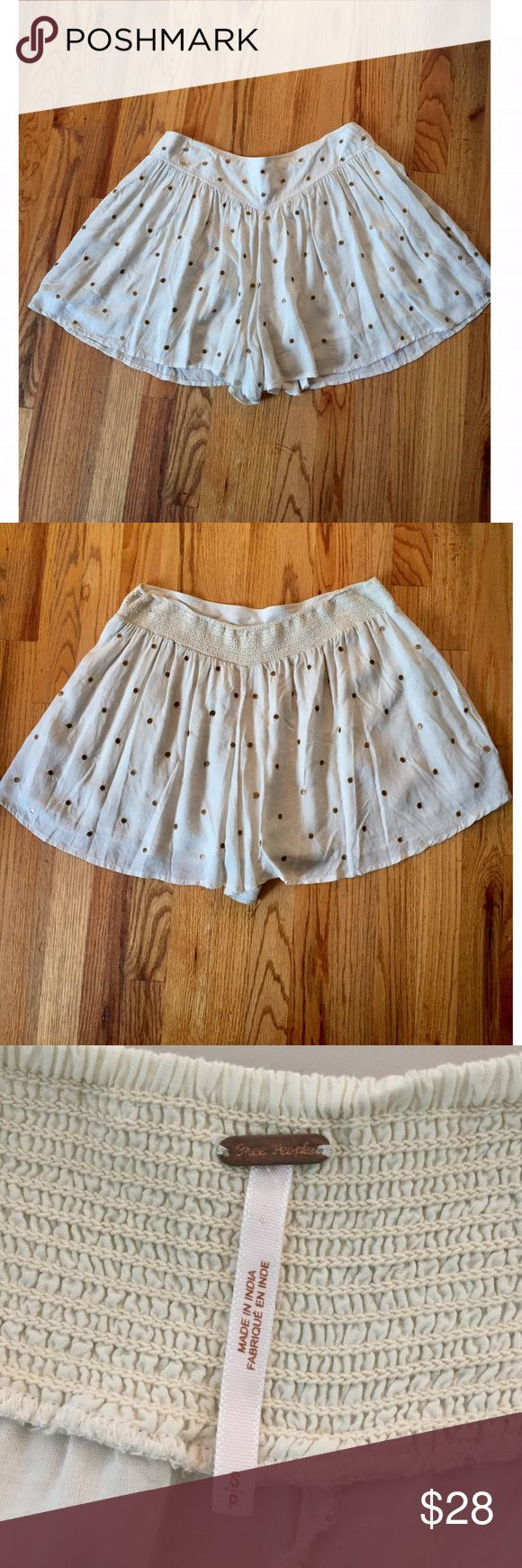 Women' Free People Flowy Shorts Free People high waisted flowy shorts. When on shorts look like a skirt. Tag reads Small, but with the elastic band the shorts fit more like a Medium to Large. Cream color with gold inlayed circles. Free People Shorts